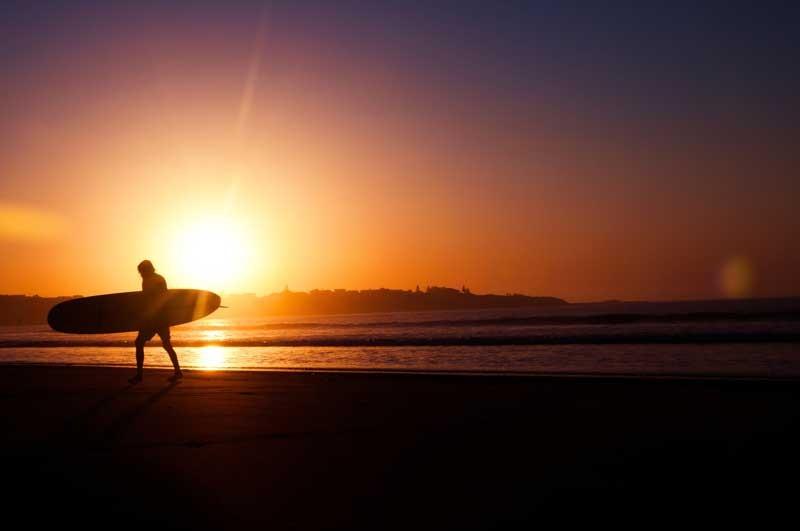 Tablou Multicanvas Surfing la Apus