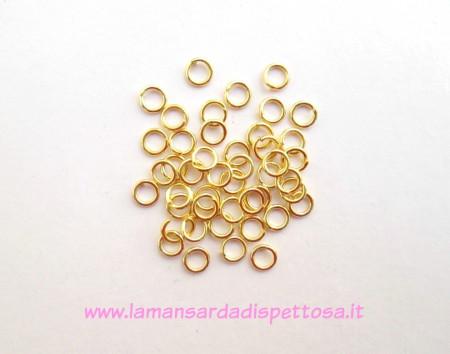 100 anellini dorati 5mm. immagini
