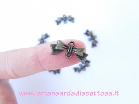 Connettore fiocco bronzo immagini