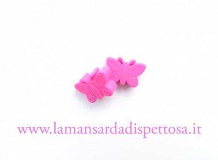 1 perla farfalla in silicone fucsia immagini