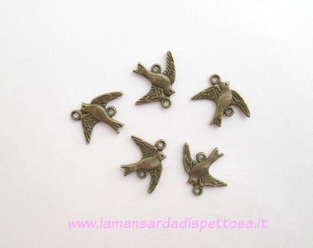 Connettori uccellini bronzo immagini