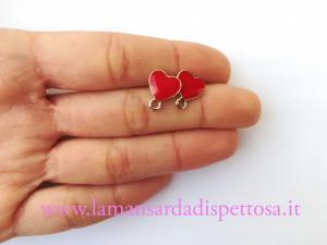 1 coppia di basi per orecchini cuore rosso 12x10mm.