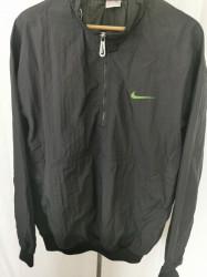 Jacheta Nike XL.