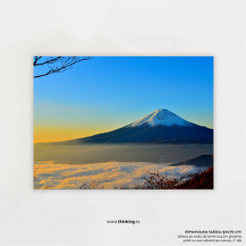 mountain over yellow white and blue sky